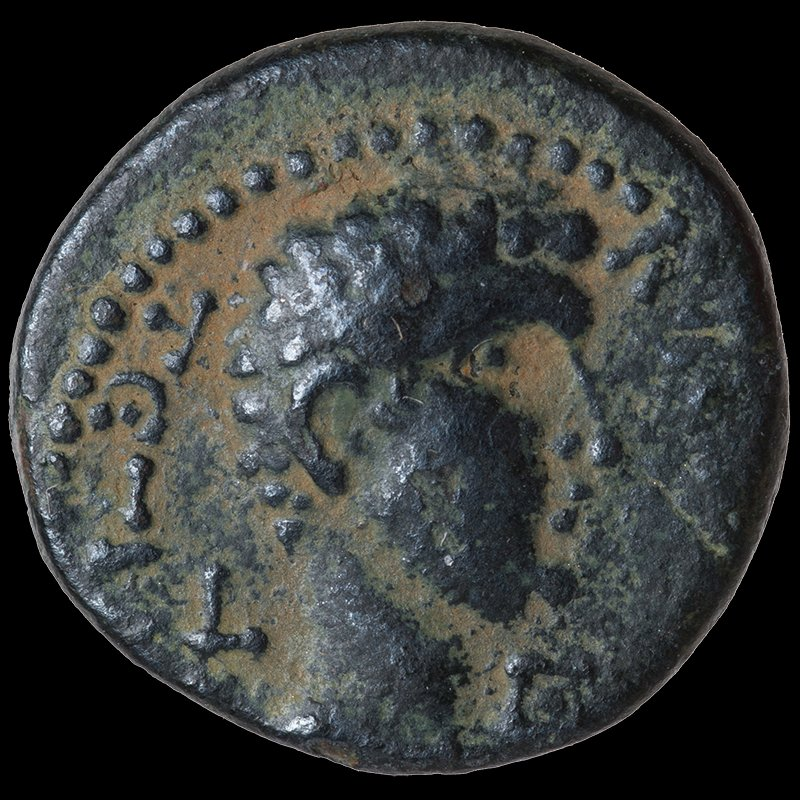 Bronze coin of Philip depicting his head and the Augusteum in Paneas (1-2 CE) - Obverse