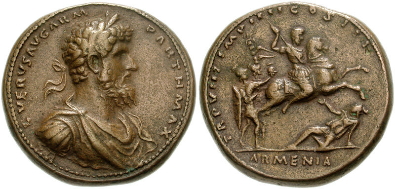 Medallion depicting the head of Lucius Verus and the emperor on horseback trampling on the personification of Armenia (165 CE)