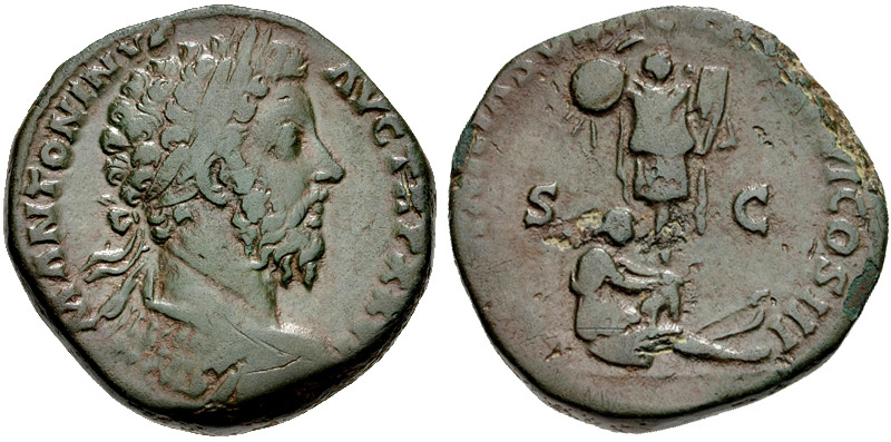 Sestertius depicting the head of Marcus Aurelius and the Germania, the personification of Germany sat at the feet of a trophy (172-173 CE)