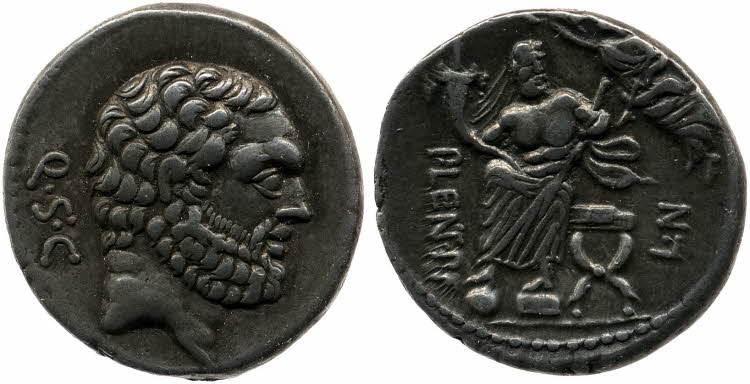 Denarius minted by P. Cornelius Lentulus Spinther, representing the Genius populi Romani seated in a curule chair and crowned by the Victory (74 BCE; RRC 397/1).