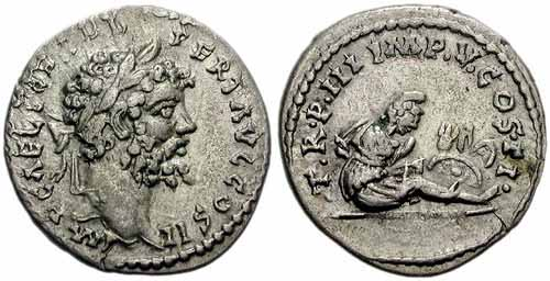 Denarius depicting the head of Septimius Severus and captives seated under a trophy (195 CE)