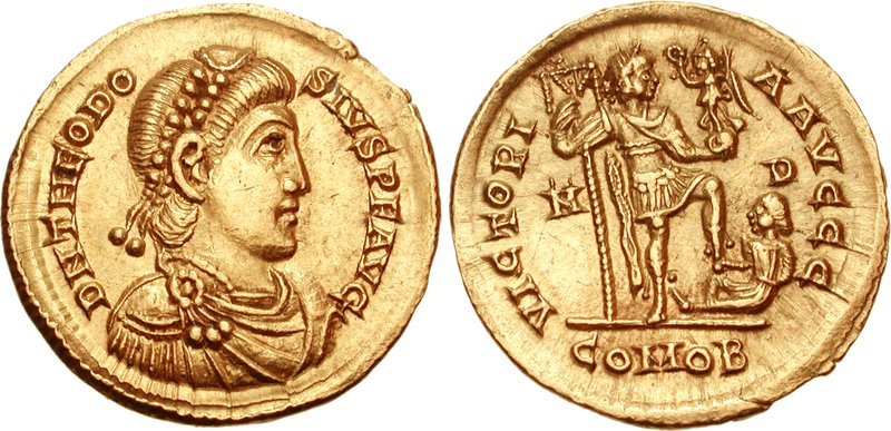 Solidus depicting the head of Theodosius I and the emperor holding the labarum and Victoria, standing on a captive (395 CE)